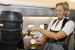 """Beer on tap"" on board Lufthansa's traditional costume flights"